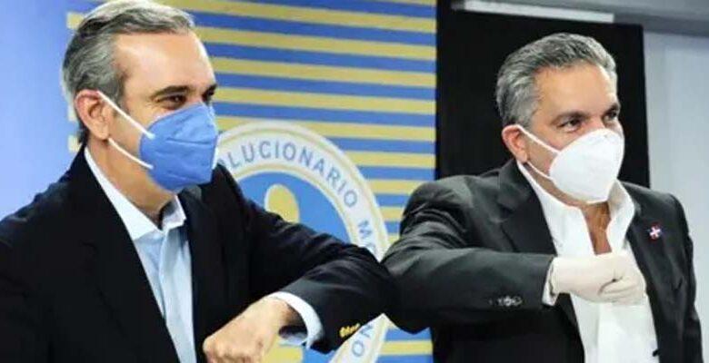 Luis Abinader, (i) y Neney Cabrera